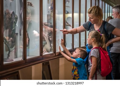 London, England - October 2018 : Mother with children looking at the display in the Horniman Museum in Forest Hill