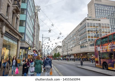 LONDON, ENGLAND - OCTOBER 21: Locals and tourists pedestrian spending their time in Oxford street, a very famous and popular shopping street in London, England, United Kingdom
