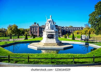 LONDON, ENGLAND - OCTOBER 22: The Great Queen Victoria statue in front of Kensington Palace in the Royal Borough of Kensington and Chelsea in London, England, United Kingdom