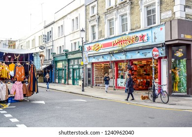 LONDON, ENGLAND - OCTOBER 23, Portobello Road Market, a famous street in the Notting Hill district of Royal Borough of Kensington and Chelsea in west London, England, United Kingdom