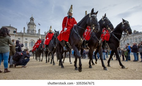 LONDON, ENGLAND – October 31, 2017 – 'The Queen's Life Guard', mounted on horses present a stirring sight as they ride through the streets of London to Change the Guard on Horse Guards Parade