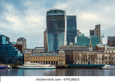 London, England - Panoramic skyline view of the famous Bank district of central London with skyscrapers, boats and blue sky