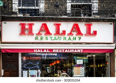 London, England - September 01, 2013: Halal Restaurant Sign, Halal food is permitted under  Islamic law, as defined in the Koran.