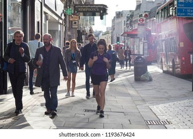 LONDON, ENGLAND - September 11 2018 People walking down the street during rush hour