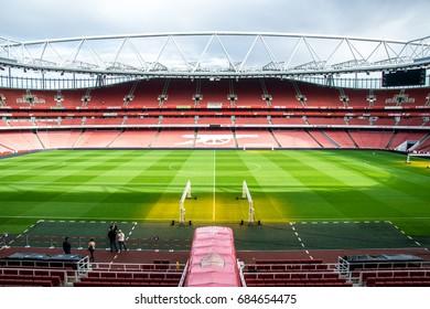 LONDON / ENGLAND - September 18, 2015 : Inside the Emirates stadium with tourists visiting the stadium tour.
