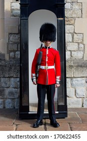LONDON, ENGLAND - SEPTEMBER 20, 2013 : Royal Guard at Tower of London on September 20,2013 in London, England. British Guards in red uniform are the sign of London.