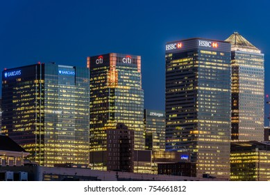 London, England, September 2017 - Offices in the financial hub of Canary Wharf light up after sunset. In the frame One Canada Square, the HSBC, CITI, JP Morgan, KPMG and Barclays buildings.