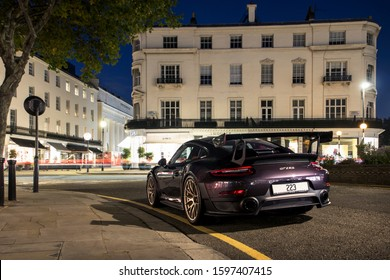 London, England - September 2019: purple Paint to Sample special Porsche 911 GT2 RS supercar parked on a street in central London, Knightsbridge area. The car is one of 1000 made.