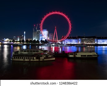 LONDON, ENGLAND - September 21, 2018: London Eye at night. LONDON, ENGLAND - September 21, 2018