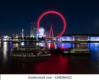 LONDON, ENGLAND - September 21, 2018: London Eye at night. LONDON, ENGLAND - September 21, 2018