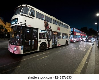 LONDON, ENGLAND - September 21, 2018:A Red an white Bus on the Street of London on September  21, 2018, London, United Kingdom