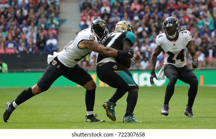 LONDON, ENGLAND - SEPTEMBER 24: Kamalei Correa for Baltimore Ravens tackles Leonard Fournette for Jacksonville Jaguars during the NFL match between The Jacksonville Jaguars and The Baltimore Ravens