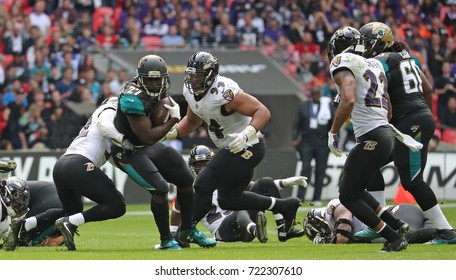 LONDON, ENGLAND - SEPTEMBER 24: Leonard Fournette running back for Jacksonville Jaguars breaks through the Ravens defence during the NFL match between The Jacksonville Jaguars and The Baltimore Ravens