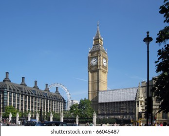 LONDON, ENGLAND - SEPTEMBER 25, 2009: Big Ben taken on September 25, 2009, with clear blue sky and with London Eye in the background.
