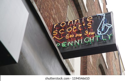 London, England September 27, 2016: People walking in front of Ronnie Scott's Jazz Club in Frith Street, Soho, London. Ronnie Scott's Jazz Club is a prominent jazz club which has operated since 1959.