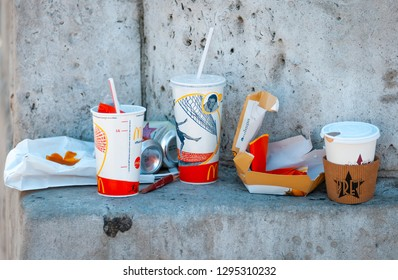 London, England - September 29, 2014: McDonald's take away wrappersl left on a wall in the street, Mcdonald's is the worlds biggest chain of fast food restaurants