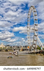 LONDON, ENGLAND - SEPTEMBER 6, 2016: The famous London Eye - popular tourist attraction in London, England, United Kingdom