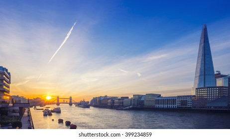 London, England - Tower Bridge and famous skyscraper at sunrise with blue sky