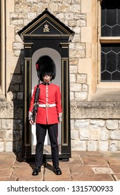 LONDON, ENGLAND, THE TOWER OF LONDON, September 2018.  The Queen's guard outside in his post in the building that exhibits the Jewels of the Crown.