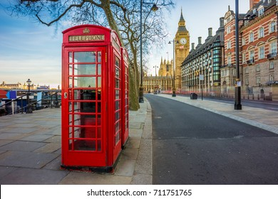 London, England - Traditional Old British red telephone box at Victoria Embankment with Big Ben at background