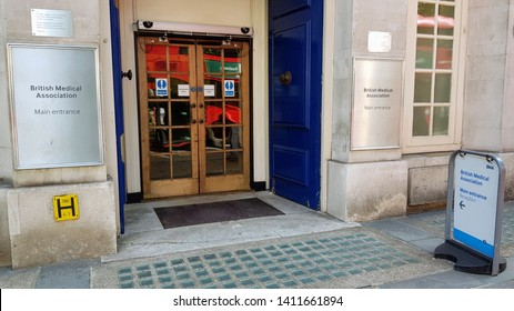London, England, UK 05/30/2019 A view of the British Medical Association main entrance with the doors open and a sign outside on the street