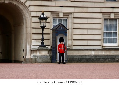 LONDON, ENGLAND, UK – 1 APRIL 2017: A Royal Guard stands at perfect attention in front of her majesty's Buckingham Palace.