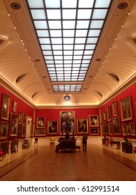 London, England, UK - 14 July 2015: Art lovers gather in the long gallery at the Wallace Collection in London. Long skylight in the ceiling above illuminated gallery with natural light..
