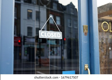 London, England, UK - 21 March 2020: 'Closed' sign outside Islington Restaurant following the Government's announcement to close down pubs/bars/restaurants to prevent the spread of Covid-19