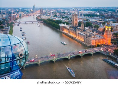 London, England, UK - August 1, 2014: Tourists are enjoying London skyline from a London Eye capsule. Also known as the Millennium Wheel, when erected in 1999 it was the world's tallest Ferris wheel.