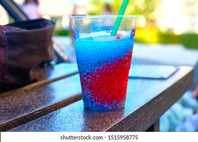 London, England, UK, August, 20th, 2019. Having a slush puppy drink outside.