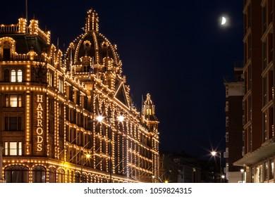 London, England, UK - August 3, 2014: Night view of the Harrods upmarket department store on Brompton Road in Knightsbridge, London.