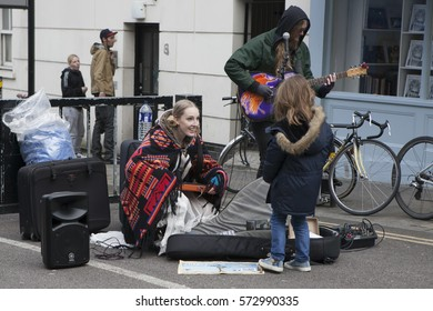 London, England, UK - August 4, 2016: Performers busking at Broadway market