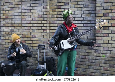 London, England, UK - August 4, 2016: Performers busking at Brick lane on Sunday