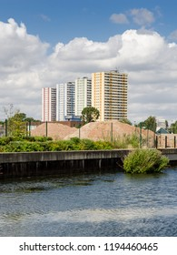 London, England, UK - July 28, 2013: Four council housing tower blocks rise behind the River Lee Navigation in Enfield, North London.
