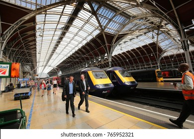 LONDON, ENGLAND, UK - JULY 7:  Passengers and commuters exiting their train walk along the platform at London Paddington Railway Station as seen on July 7, 2017.