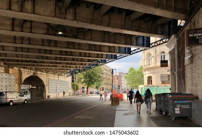 London, England / UK - July 8 2019: Street with railway underpass in Southwark