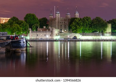 London, England, UK - June 15, 2011: Traitor's Gate and the White Tower of the Tower of London are lit at night on the banks of the River Thames.