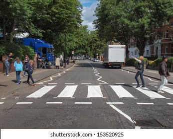 LONDON, ENGLAND, UK - JUNE 18: Abbey Road zebra crossing made famous by the 1969 Beatles album cover on June 18, 2011 in London, England, UK