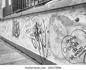 LONDON, ENGLAND, UK - JUNE 18, 2011: Graffiti by Beatles fans on the wall of the Abbey Road studios where the homonymous album was recorded in 1969