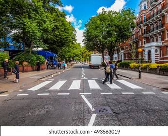 LONDON, ENGLAND, UK - JUNE 18: People crossing the Abbey Road zebra crossing made famous by the 1969 Beatles album cover on June 18, 2011 in London, England, UK (HDR)