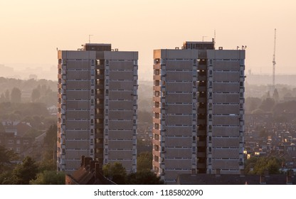 London, England, UK - June 20, 2013: A pair of high-rise council estate tower blocks stand over streets of terraced houses in the Tooting neighbourhood of South London.