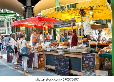 LONDON, ENGLAND, UK - JUNE 6, 2013: Specialty food stalls at Borough Market in London