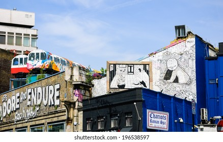 LONDON, ENGLAND, UK - MAY 4, 2014: Black and white graffiti (created by MIIIO and NoBearWalls) on Village Underground wall. Urban art in this area attracts tourists from all over the world.
