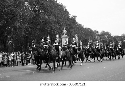 LONDON, ENGLAND, UK - MAY 5, 2014: Royal Guards during traditional Changing of the Guards ceremony near Buckingham Palace. This ceremony is one of the most popular tourist attractions in London.