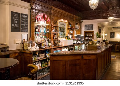 London, England, UK - may 8, 2014: View of the interior of a pub decorated with elegant wooden furniture in the historic center of the city