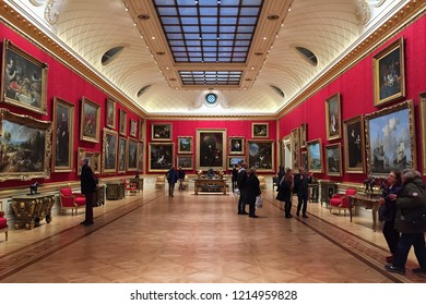 LONDON, ENGLAND, UK - NOVEMBER 18, 2017 : Art lovers gather in the long gallery at the Wallace Collection in London. Long skylight in the ceiling above illuminated gallery with natural light.