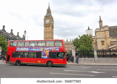 London, England, UK - October 12, 2013: London Bus with Big Ben at Westminster Abbey. The London Bus service is one of the largest urban bus networks in the world