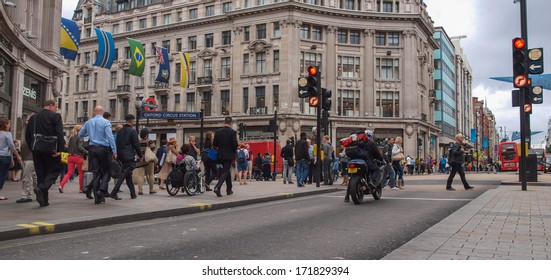 LONDON, ENGLAND, UK - SEPTEMBER 10, 2012: Oxford Street is one of the busiest high streets with tourist strolling in the winter shopping season