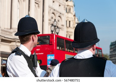 LONDON, ENGLAND, UK - SEPTEMBER 28, 2008: Police officers on the beat in Piccadilly Circus, London, England, UK