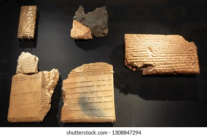 London, England / United Kingdom - 2019/01/28: Ancient Assyria clay tablets with Mesopotamian cuneiform writing from king Ashurbanipal royal library in Nineveh in British Museum in London